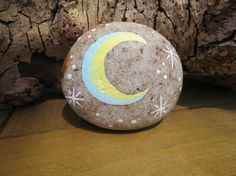 Ive painted a sun on one side of this rock, and a moon and star