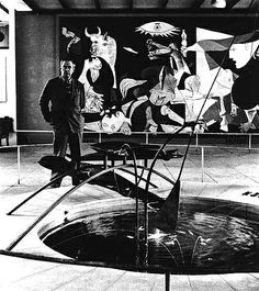 Alexander Calder in front of Picasso's Guernica with his Mercury Fountain at the Spanish Pavilion in 1937