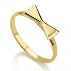This 24K gold plated bow ring is simply adorable. Wear it as a knuckle ring or as a classic ring. Wear it alone or stacked.