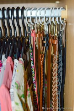 "Shower rings are multitasking pros. Use them to corral your belts together, either all on one ring or displayed side-by-side. No more frantic ""where is my pink skinny belt that goes perfect with this outfit"" moments in the morning.  Get the tutorial here.   - Redbook.com"