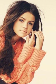 Selena Gomez omg shes so perfect its not even fair lol i love her shes soooo pretty and has a nice voice