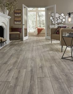 "A European white oak look that evokes images of gently time-worn flooring in French chateaus, Mannington's Blacksmith Oak laminate (color ""Anvil"" shown) is a sophisticated rustic with rich color and grain, and beautiful color play from plank-to-plank. The embossed in register planks are 8-inches wide: http://www.mannington.com/Residential/Laminate/Restoration-Collection/Blacksmith-Oak/28302 Wide Plank Laminate Flooring, Mannington Laminate Flooring, Laminate Flooring Colors, Bedroom Laminate Flooring, Flooring Options, Flooring 101, Flooring Ideas, Living Room Flooring, Best Flooring"