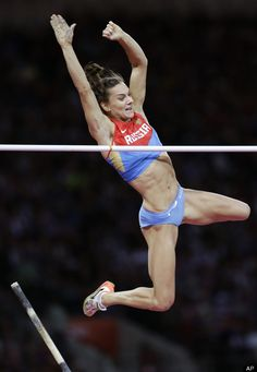 Russias Yelena Isinbayeva Clears The Bar In The Womens Pole Vault Final During The Athletics In