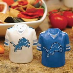 Detroit Lions Gameday Salt And Pepper Shakers by The Memory Company. $17.99. Hand painted. NFL licensed. Approximately 3 inches tall by 2.5 inches wide. Bring some team spirit to the table with these adorable ceramic salt and pepper shakers! The Detroit Lions Gameday salt and pepper shakers are perfect whether you're tailgating or having some friends over to watch the big game. Each shaker is hand painted in vivid colors and clearly labeled salt and pepper for easy use.