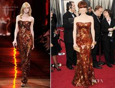 Ellie Kemper borrows a dress from Katniss for the Oscars. Looks amazing.