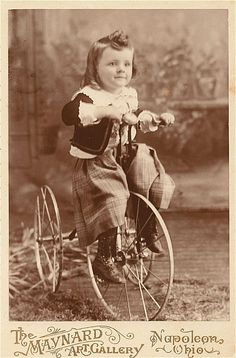 Boy from Napoleon Ohio on his tricycle, antique Victorian cabinet card photo.