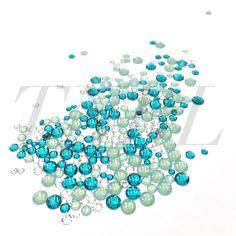 Mixed pack of Swarovski Colour Crystals 400pcs  Colours chosen to compliment each other.  Contains:  Blue Zircon  - SS7 60pcs  - SS12 60pcs  - SS20 50pcs  Pacific Opal  - SS12 60pcs  - SS20 50pcs  Clear  - SS7 60pcs  - SS12 60pcs