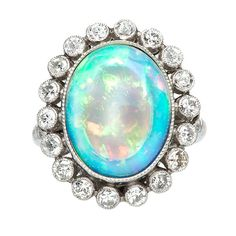 Opal Diamond Ring | From a unique collection of vintage engagement rings at https://www.1stdibs.com/jewelry/rings/engagement-rings/ 4450