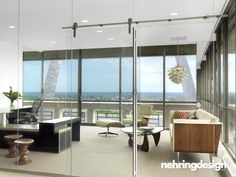 All glass office wall prevents blocking windows. In just a few spaces.