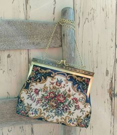 Check out this item in my Etsy shop https://www.etsy.com/listing/266811478/retro-tapestry-purse-on-a-gold-swing