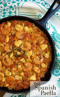 We've taken all the essentials of Spanish Paella and added our own tricks to make an incredibly Easy Paella Recipe that can be made in 30 minutes! | www.CuriousCuisiniere.com