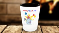 .Happy 4th of July - Independence Day Shot Glass - Cute Elephant waving U.S. Flag with Red, White and Blue Flag Hat.  Stars and Balloons in the background - Happy 4th of July Shot Glass