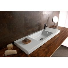 The contrast between the wood and sink are great in this pic #sinks