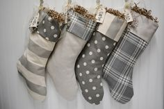 Set of 4 Christmas stockings in grey and white with embroidered name tags by TurnbowDesigns on Etsy https://www.etsy.com/listing/252751791/set-of-4-christmas-stockings-in-grey-and