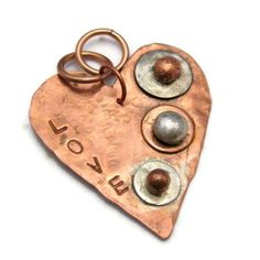Copper Pendant Sterling Silver Love Heart Pendant Textured Pendant. $59.00, via Etsy.