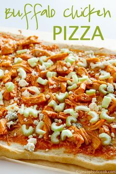 Buffalo Chicken Pizza  -- shredded chicken smothered in classic buffalo sauce, topped with mozzarella, blue cheese, celery, and creamy blue cheese dressing, this buffalo chicken pizza recipe is a real winner!