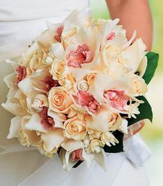 White Roses and pale colored Orchids with white seashell accents make this a beautiful tropical bouquet