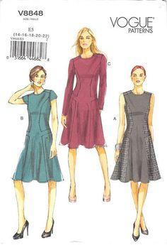 Dress (close-fitting through bust) has seam detail, back zipper and narrow hem.