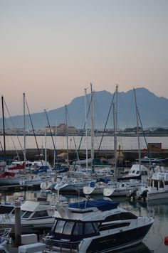 Helderberg mountain just after sunset - as seen from Gordons Bay yacht club. Harbour Island also visible on the horison - Helderberg, Cape Town, Guinea Bissau, Yacht Club, Cape Town, Bay Area, Tanzania, Cabo, San Francisco Skyline, South Africa, Beautiful Places