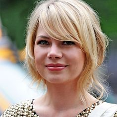 Love the bang with the low and messy style!