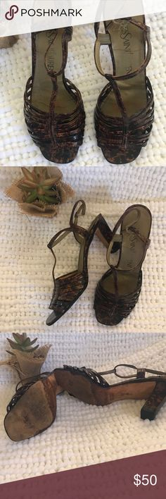 Vintage Yves saint Laurent tortoise sandals Vintage yves saint laurent tortoise color sandaled heels in fair condition leather made in Italy size 7.5 may need the back elastic fixed and the patent leather straps re glued so please ask questions and if you need more pictures I can gladly provide these are in good vintage condition Yves Saint Laurent Shoes Heels