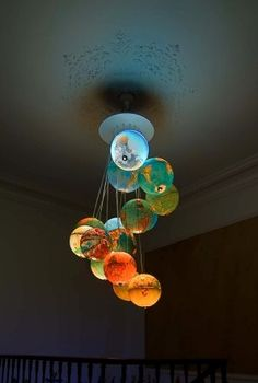 a globe lamp . ((I've left in other pinner's comments:Globe lamp, possibly DIY? Desk Globe, Globe Lamps, Globe Chandelier, Globe Lights, Chandeliers, Light Globes, Solar Chandelier, Chandelier Ideas, Pendant Lamps