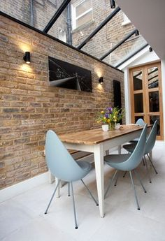 Charming Dining Rooms With Exposed Brick Wall modern dining room with glass ceiling, brick wall and excellent blue chairs.modern dining room with glass ceiling, brick wall and excellent blue chairs. Dining Room Design, Dining Area, Dining Rooms, Dining Chairs, Dining Decor, Dining Table, Design Room, Home Design, Interior Design
