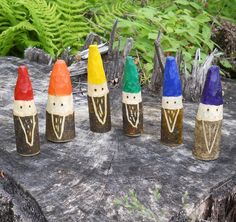 Rainbow Gnomes, carved by a child.
