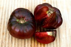 HEIRLOOM Ukraine. Indeterminate. The deep red fruits appear to be a shiny black while the interior is a reddish green. Surprisingly, this very old, very sweet, fairly large tomato is also very early.