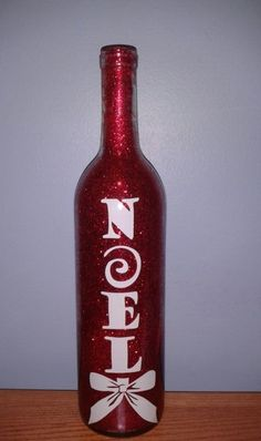 Holiday Glitter Wine Bottles with glitter on the INSIDE! No mess. Each item is made to order. Variety of glitter & vinyl colors available. Call for more details! www.stone-effects.com (Glitter Liquor Bottle)