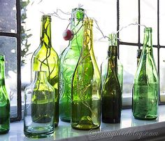 Ok how easy and simple is this: re-purpose some old green bottles, add a string of lights and you have a quick and lovely display for the window sill. Green decorating for sure!