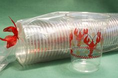 Clear 16oz disposable cups packed in a sleeve of 50 and tied with ribbon. Great for crawfish boils!