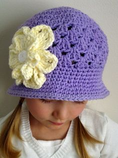 This is hand crocheted brimmed beanie hat for a little girl