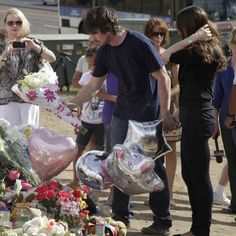 Christian Bale visiting memorial for the shooting victims in Denver.