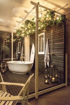Studio Sally Taylor - Window Project Left: Perrin & Rowe outdoor bare brass bath filler and Victoria & Albert Amiata bath Right: Perrin & Rowe outdoor bare brass shower set