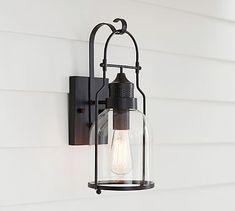 How cool would this be by your door with a green door?! Taylor Indoor/Outdoor Sconce #potterybarn