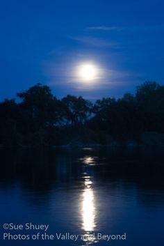 Reflection of the rising moon across the Sacramento River.