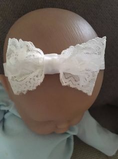 A personal favourite from my Etsy shop https://www.etsy.com/uk/listing/543276801/baby-christening-headband-lace-bow