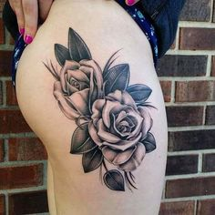 Roses on right hip by tattoo artist Nhia Yang.