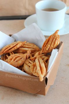 This tea-time snack has a unique shape, can be made in three ways (savory, sweet, and spicy), and has several names. Indian Desserts, Indian Snacks, Indian Dishes, Indian Food Recipes, Vegetarian Recipes, Snack Recipes, Cooking Recipes, Indian Sweets, Rice Recipes