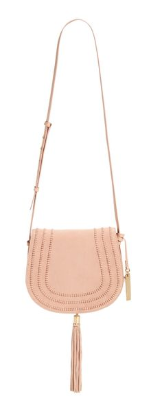 The it handbag for Spring: The saddle bag. Super spacious, soft leather and an adjustable crossbody strap. Love the tassel and hardware that ads some edgy flair!