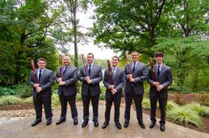 Groomsmen in grey suits, with custom bats as their gift! | Ashley & Jon's Elegant Warehouse Wedding at the Annapolis Fairgrounds in Maryland | Images: Eastport Photography