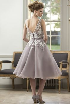 M570 - T-length bridesmaid dress with lace bodice and satin sash with bow at waist. Zip up back with button trim. Pictured here in Ivory Lace/Fino Lavender Organza. #bridesmaids