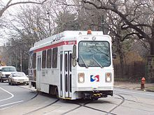 A white single-car trolley in street running. SEPTA, Phila.