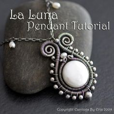 Stunning pendant ... I wonder how the center stone is anchored???  Hmmm...