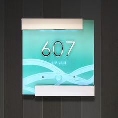 Drawing inspiration and design cues from the distinct flavor and heritage of the Art Deco District of South Miami, Axxess used etched clear acrylic over a painted acrylic panel with backlit LEDs and stainless steel accents to bring the ocean to your hotel room door both the day and night.