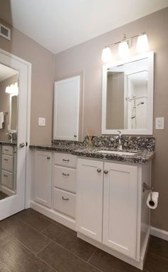 Pic Of KraftMaid dove white vanity with Cambria Braemar and wood plank tile