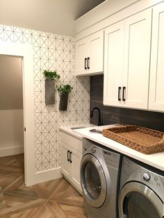 Geometrical wallpaper in the laundry room, and those floors - so pretty!