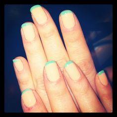 Zooey Deschanel's mint green manicure.
