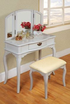 Give your home a sophisticated flair with this gorgeous white tri-mirror vanity. Featuring elegant curved legs, exquisite hardware, a crisp white finish, and subtle beige upholstery, this vanity set e Vanity Table Organization, Bathroom Vanity Storage, Bathroom Faucets, Vanity Set With Mirror, White Vanity, Mirror Desk, Dresser Furniture, Bedroom Furniture, Furniture Ideas
